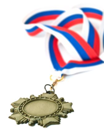 medal and ribbon close-up. isolated over white. shallow dof