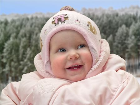 little girl in winter clothes outdoor portrait over winter landscape