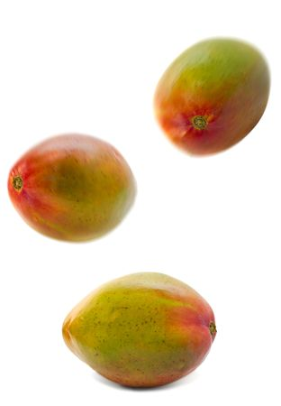 falling mango group isolated over white. motion blur