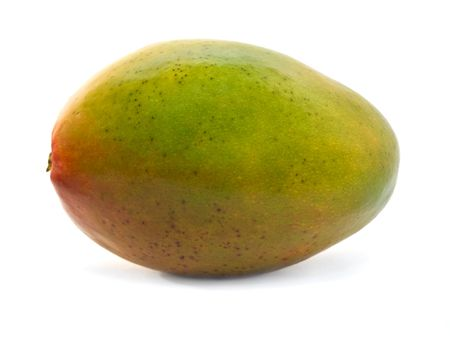 vibrant colours: close-up of mango fruit isolated over white. vibrant colours