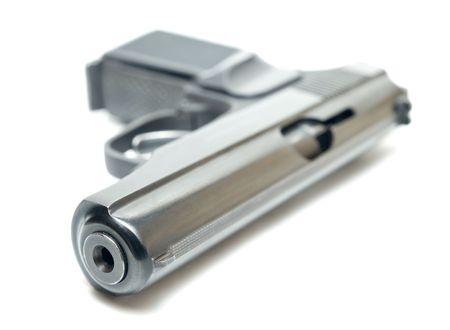 high key close-up of gun isolated on white shallow dof Stock Photo