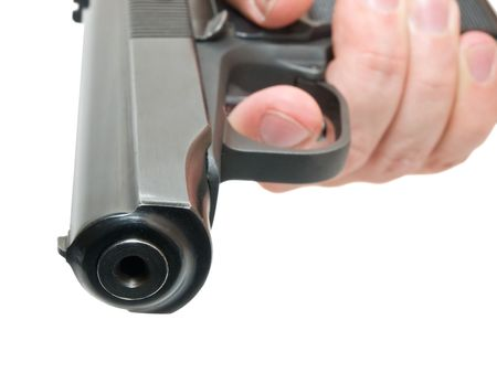 close-op of gun on hand isoladed over white. shallow dof