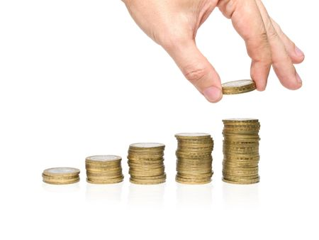 stacks of coins and human hand isolated on white. savings concept Stock Photo - 3446709