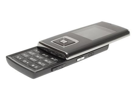dark cellphone isolated over white. shallow dof