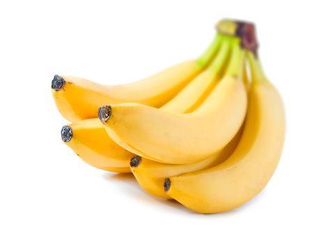 bananas isolated on white background. shallow dof Stock Photo