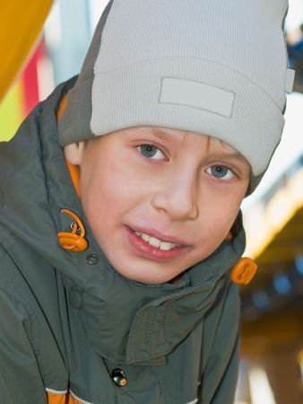 caucasian boy in cap outdoor portrair. tag label removed photo