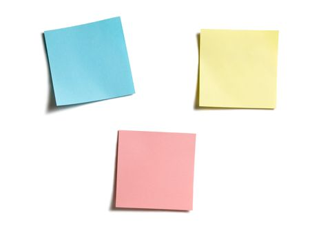 three color stick notes isolated on white photo