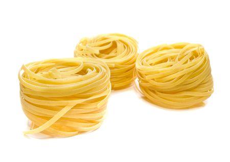 pasta tagliatelle isolated on white. shallow dof