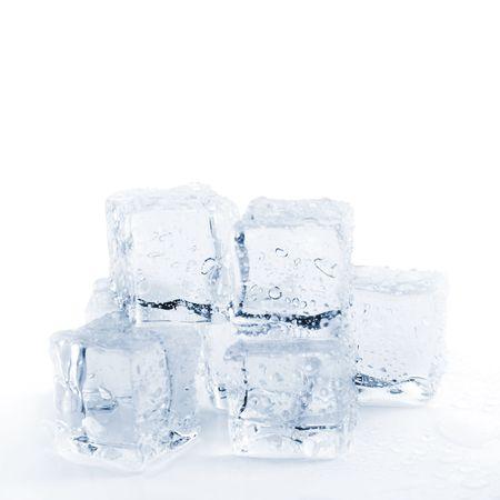 melting ice cubes over white toned blue closeup shallow dof