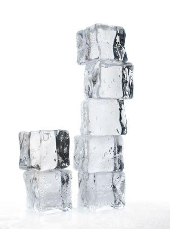 melting ice cubes over white closeup shallow dof
