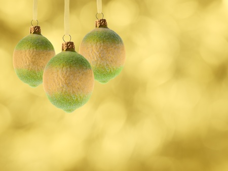 christmas balls lemon fruits decoration over blurred background photo