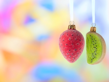 christmas balls fruits decoration over blurred background photo