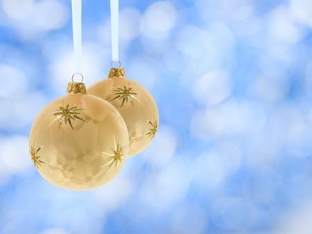 cristmas balls decoration over blurred lights blue background photo