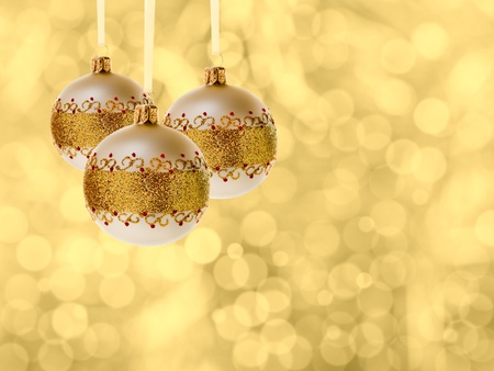 cristmas balls decoration over blurred lights golden background photo