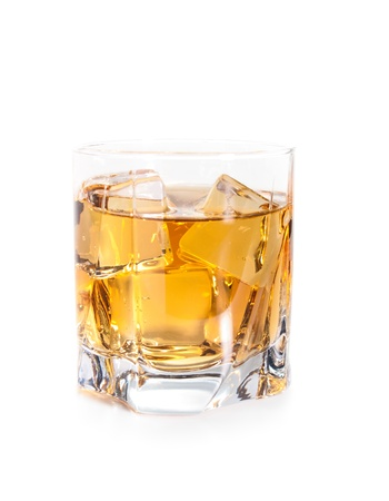 hard liquor: glass of whiskey with ice cubes isolated on white