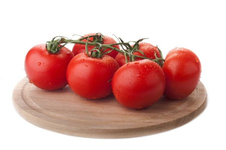 tomato brunch on wooden plate isolated over white photo