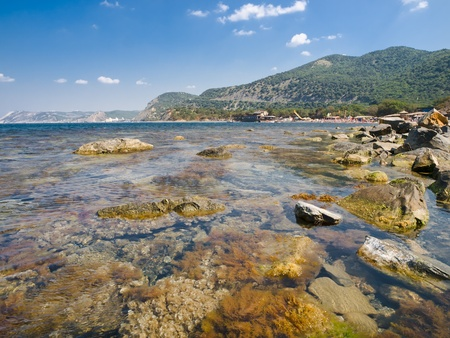 summer landscape with sea rocks and skies with clouds Stock Photo - 10879015
