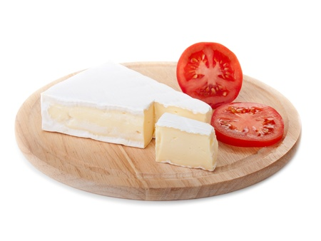 brie cheese and tomato slice on wood plate isolated photo
