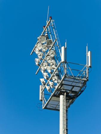 stadium floodlight tower over blue sky photo