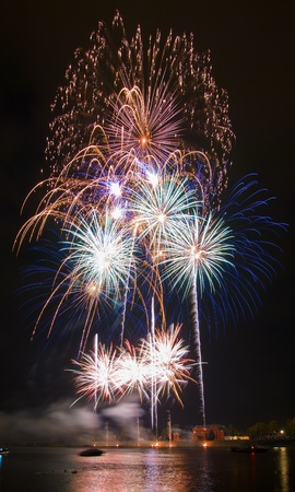 colourful fireworks display over the river Stock Photo