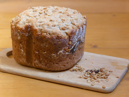 home made bread with muesli on desk  shallow dof Stock Photo