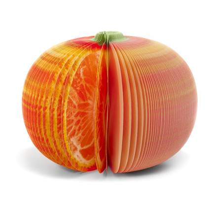 paper stick note memo pad looking like grapefruit or mandarine isolated on white