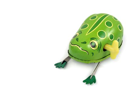 engaging: wind-up toy frog set against a white background Stock Photo
