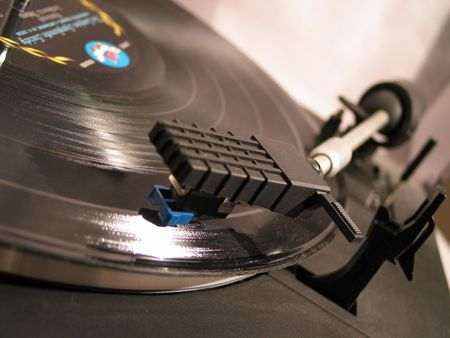 record spinning on a turntable - focus on the needle Reklamní fotografie