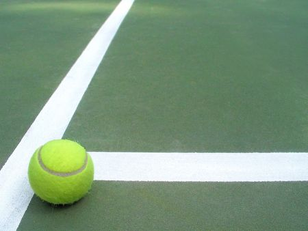 a lone tennis ball that has rolled to a stop in the Foto de archivo