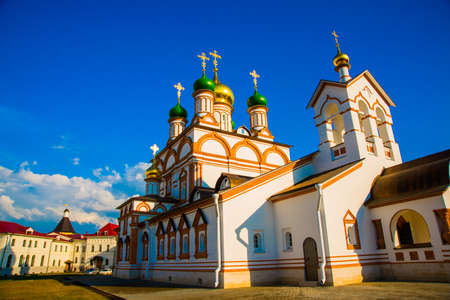 annunciation: Beautiful vintage Orthodox religious structures on the background of blue sky.Spring Sun. Stock Photo