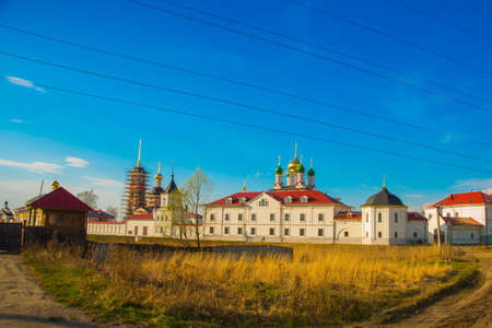 disruption: Beautiful vintage Orthodox religious structures on the background of blue sky.Spring, Sun. Stock Photo