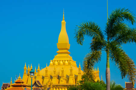 depicted: Golden stupa is the symbol of Laos, depicted on the flag of the country.