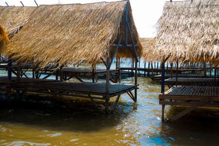 feudalism: Island with houses made of straw near the river in Cambodia.