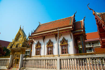 Ancient Buddhist temples with gold in a small town in Thailand.Khon Kaen photo