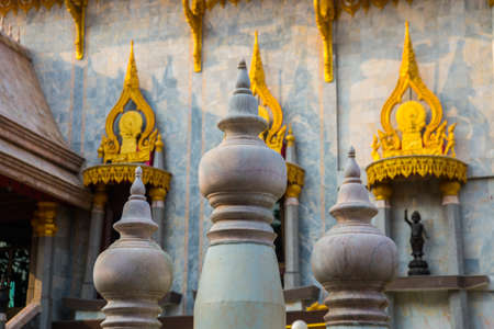 Ancient Buddhist temples with gold in a small town in Thailand. Nakhon Ratchasima. photo