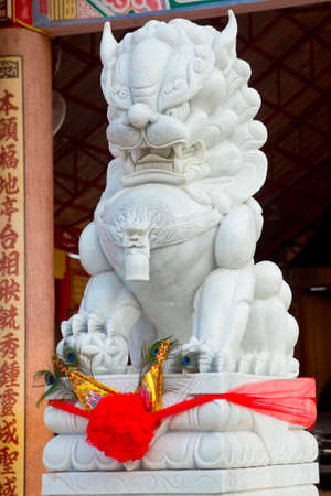 heritage protection: chinese lion statue.Udon Thani, Thailand Stock Photo