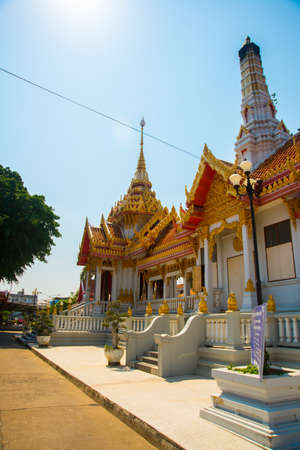 the gilding: Beautiful religious building is white with gilding on a blue sky background. Ayutthaya. Thailand. Stock Photo