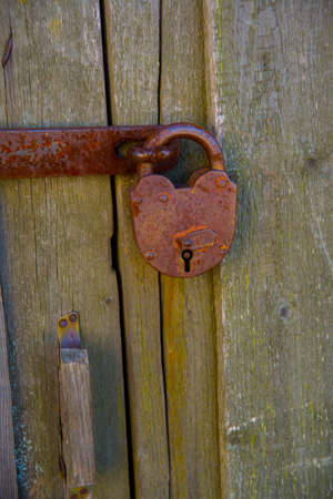 weighs: Old door at the temple, which weighs iron padlock