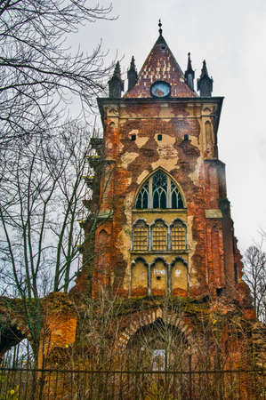 selo: Autumn.Russia,the town of Pushkin, Tsarskoe Selo. Alexander park.Chapelle, an old ruined tower in the Gothic style
