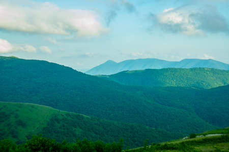 typically scottish: The peaks of blue-green mountains against the sky,the summer.Gelendzhik.Russia.