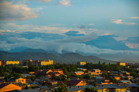 typically scottish: The peaks of blue-green mountains against the sky,the summer.The Caucasus..Russia,the city of Vladikavkaz Stock Photo