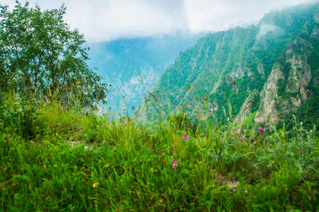 typically scottish: White clouds and mountains in rainy weather.Summer..The Caucasus..Russia.
