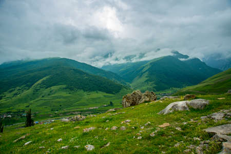 typically scottish: Beautiful mountains in the clouds on the blue sky background,the summer.The Caucasus..Russia.