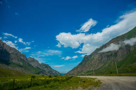 typically scottish: The peaks of blue-green mountains against the sky,the summer.The Caucasus..Russia.