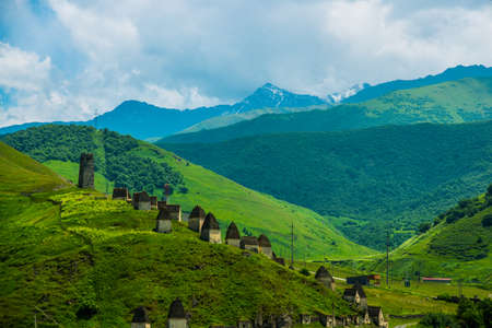 highland region: City of the dead.Stone ancestral tombs on the hill with mountains in the background, inside the bone. The Caucasus.Russia.