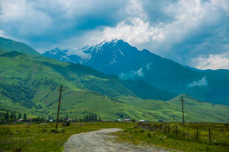 highland region: Beautiful mountains in the clouds on the blue sky background,the summer.The Caucasus..Russia.