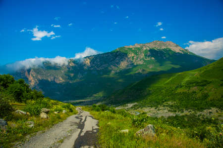 highland region: The peaks of blue-green mountains against the sky,the summer.The Caucasus..Russia.