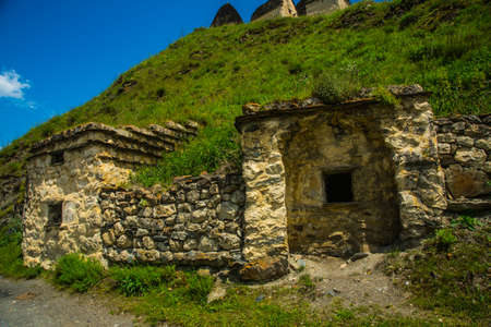 svaneti: City of the dead.Stone ancestral tombs on the hill with mountains in the background, inside the bone. The Caucasus.Russia.