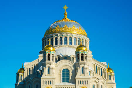 gilt: Naval St. Nicholas Cathedral in Anchor square, a Church with a large dome decorated and gilt against a blue sky.Kronstadt.Russia.