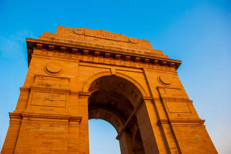 monument in india: NEW DELHI, INDIA. The Indian gate and tourists are in New Delhi,India. The Indian gate is the national monument of India.